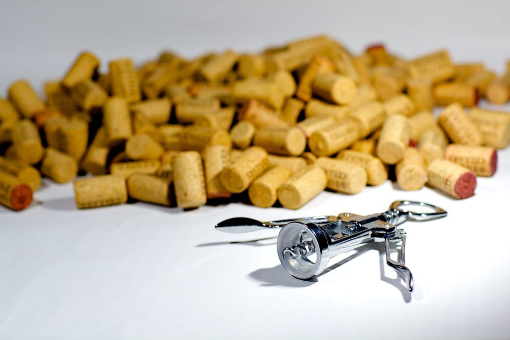pile-of-corks-and-corkscrew